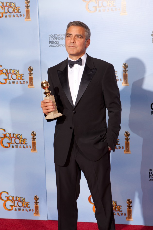 """Winning the category of BEST PERFORMANCE BY AN ACTOR IN A MOTION PICTURE – DRAMA for his role in """"The Descendants,"""" actor George Clooney poses backstage in the press room with his Golden Globe Award at the 69th Annual Golden Globe Awards at the Beverly Hilton in Beverly Hills, CA on Sunday, January 15, 2012"""
